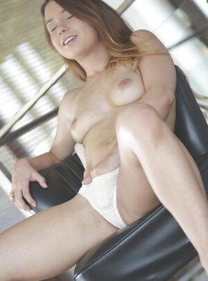 Desirable angel Taylor Sands gets comfortable on the chair to play with cum bucket