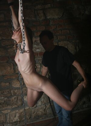 Skinny 18-19 y.o. gags on master's fuckstick after bondage domination in air