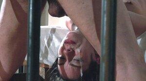 Slim brunette facialized after fetish sex with master in strange prison cell