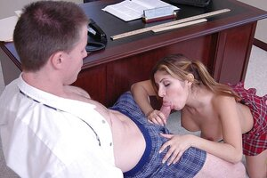 Mexican Soccer mom Sativa Rose in a checkered skirt gives a blowjob to boss