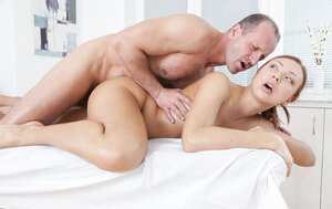 Masseur turns on customer with red hair touching pussy and additionally she lets drill it