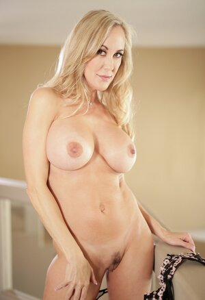 Tight dress motivates alone blonde cougar to free sizeable breasts from it
